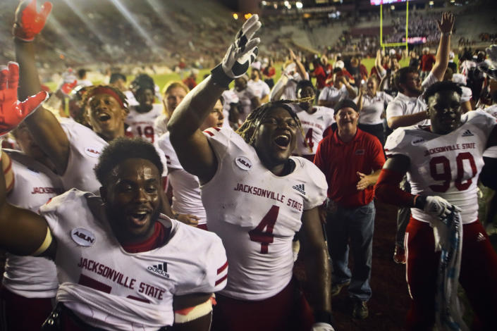 Jacksonville State players celebrate after a 20-17 win in an NCAA college football game against Florida State on Saturday, Sept. 11, 2021, in Tallahassee, Fla. (AP Photo/Phil Sears)