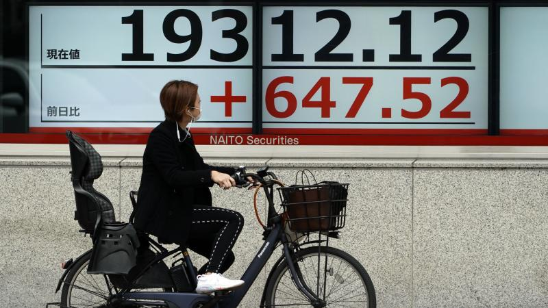 Markets in Asia advance on hopes of US stimulus package