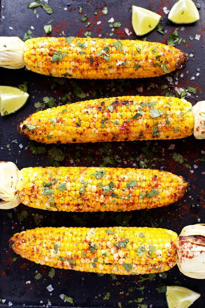 """<p>Dig into this corn on the cob seasoned with tangy lime, spicy paprika, and cilantro. </p><p><strong>Get the recipe at </strong><a href=""""http://blissfulbasil.com/2015/06/10/grilled-cilantro-lime-paprika-corn-on-the-cob/"""" rel=""""nofollow noopener"""" target=""""_blank"""" data-ylk=""""slk:Blissful Basil"""" class=""""link rapid-noclick-resp""""><strong>Blissful Basil</strong></a><strong>.</strong></p>"""