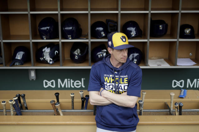 FILE - In this Saturday, March 2, 2019, file photo, Milwaukee Brewers manager Craig Counsell waits in the dugout for the start of a spring baseball game against the Chicago Cubs in Mesa, Ariz. The Brewers are well-positioned for more success this year after winning the NL Central and making it to the NL Championship Series last October. (AP Photo/Chris Carlson, File)