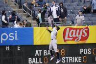 A fan catches a ball hit by Tampa Bay Rays' Francisco Mejia for a home run as New York Yankees right fielder Aaron Judge (99) leaps at the wall during the second inning of a baseball game Saturday, April 17, 2021, in New York.(AP Photo/Frank Franklin II)