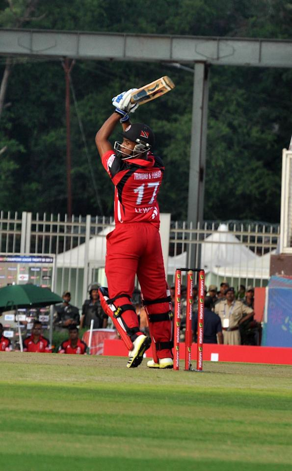 Trinidad & Tobago batsman in action during the Champions League T20, 2nd match, Group B between Brisbane Heat and Trinidad & Tobago at JSCA International Cricket Stadium, Ranchi on Sept. 22, 2013. (Photo: IANS)