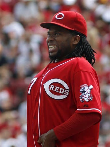 Cincinnati Reds' Johnny Cueto reacts after Houston Astros' Matt Dominguez hit a three-run home run off him in the third inning of their baseball game in Cincinnati, Sunday Sept. 9, 2012. (AP Photo/Tom Uhlman)