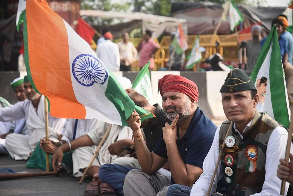"""<div class=""""paragraphs""""><p>New Delhi: Farmers with supporters block a road during their Bharat Bandh strike against central governments three farm reform laws, at Ghazipur border.</p></div>"""