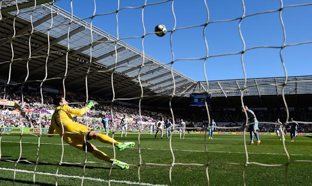 <p>Marko Arnautovic blazes a penalty over the bar for Stoke, who concede a second goal against Swansea just a minute later </p>