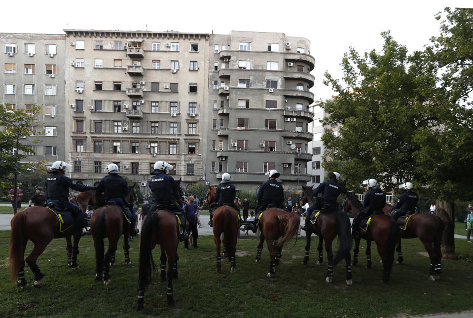Police on their horses guard the area as people gather for a demonstration in Belgrade, Serbia, Wednesday, July 8, 2020. Serbia's president Aleksandar Vucic backtracked Wednesday on his plans to reinstate a coronavirus lockdown in Belgrade after thousands protested the move and violently clashed with the police in the capital. (AP Photo/Darko Vojinovic)