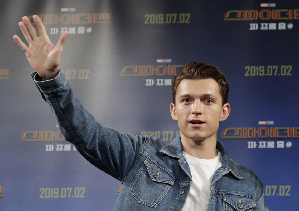 """Actor Tom Holland waves upon his arrival at a press conference for his new movie """"Spider-Man: Far From Home"""" in Seoul, South Korea, Monday, July 1, 2019. The movie is to be released in South Korea on July 2, 2019. (AP Photo/Lee Jin-man)"""