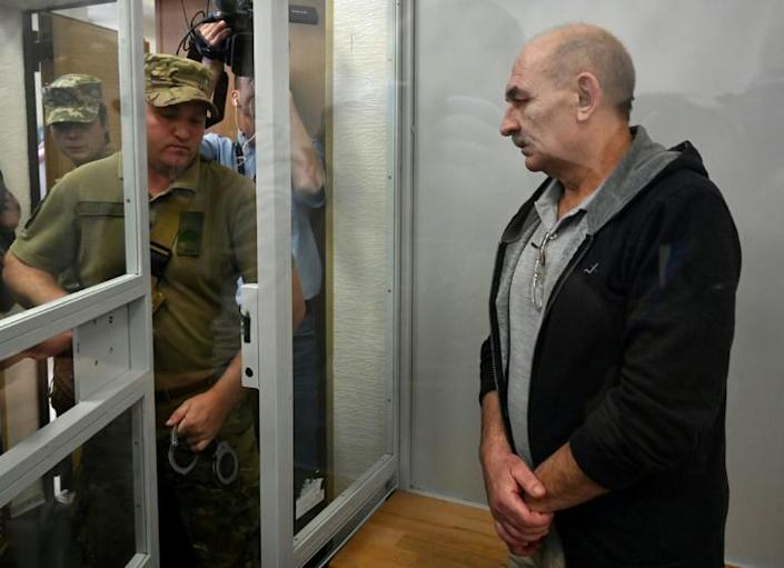 Vladimir Tsemakh -- a fighter with Moscow-backed separatists considered a key witness in the downing of flight MH17 -- was handed over to Russia (AFP Photo/Sergei SUPINSKY)