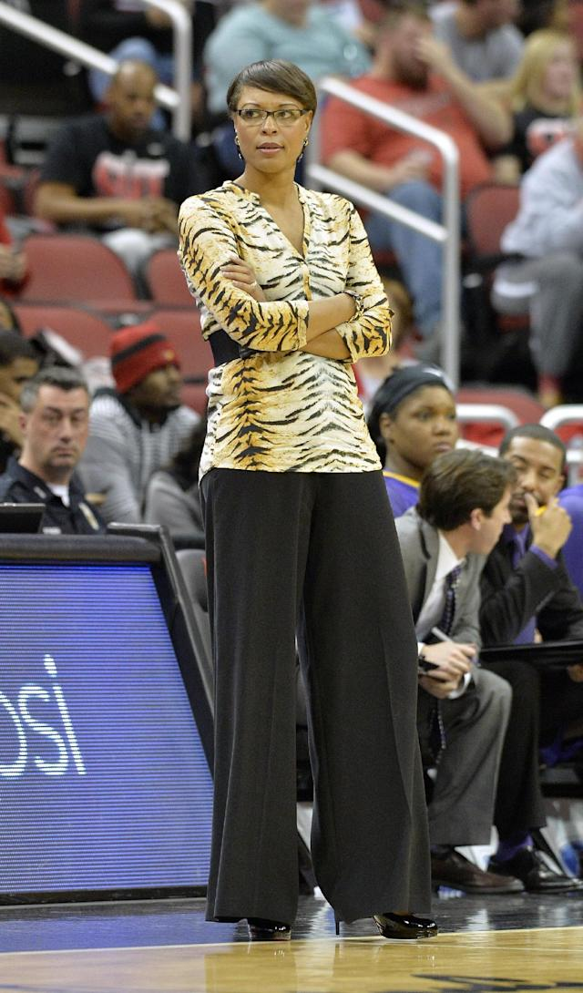 LSU head coach Nikki Caldwell reacts to a call during the second half of an NCAA college basketball game against Louisville, Thursday, Nov. 14, 2013, in Louisville, Ky. Louisville defeated LSU 88-67. (AP Photo/Timothy D. Easley)