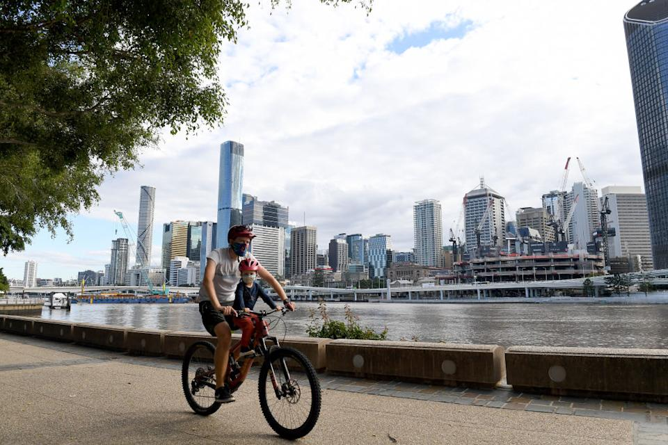 People are seen doing their early morning exercise in Brisbane, Australia during lockdown.