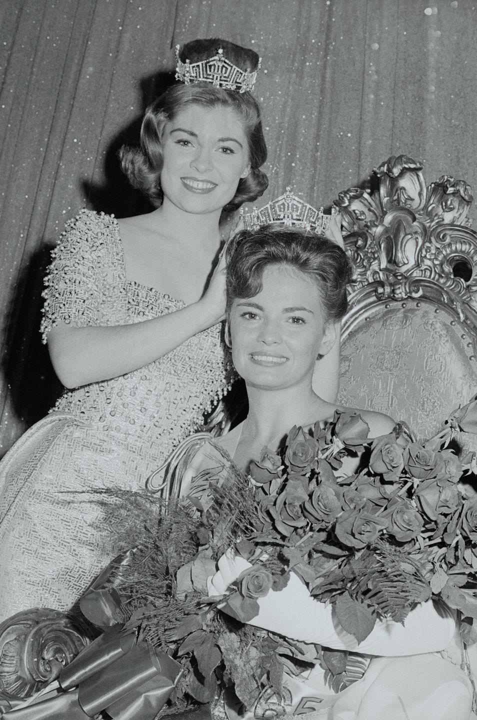 <p>Donna Axum of Arkansas, left, rocks a beaded gown, as she prepares to pass her title on to the following year's winner, Vonda Van Dyke.</p>