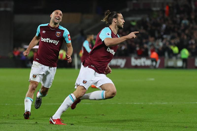 Positive impact: Andy Carroll celebrates his late equaliser against Stoke (Getty Images)