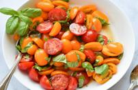"""<p>If you're a tomato lover, then this salad is guaranteed to be a summer staple. The simple dish takes just five minutes to prepare and requires few ingredients. Its bright colors and flavor will serve as a great side dish to hearty entrees like <a href=""""https://www.thedailymeal.com/our-50-best-burger-recipes-gallery?referrer=yahoo&category=beauty_food&include_utm=1&utm_medium=referral&utm_source=yahoo&utm_campaign=feed"""" rel=""""nofollow noopener"""" target=""""_blank"""" data-ylk=""""slk:burgers"""" class=""""link rapid-noclick-resp"""">burgers</a> and <a href=""""https://www.thedailymeal.com/cook/how-to-make-cheap-steak-tender-delicious?referrer=yahoo&category=beauty_food&include_utm=1&utm_medium=referral&utm_source=yahoo&utm_campaign=feed"""" rel=""""nofollow noopener"""" target=""""_blank"""" data-ylk=""""slk:steak"""" class=""""link rapid-noclick-resp"""">steak</a>.</p> <p><a href=""""https://www.thedailymeal.com/recipes/marinated-tomato-basil-salad-recipe-0?referrer=yahoo&category=beauty_food&include_utm=1&utm_medium=referral&utm_source=yahoo&utm_campaign=feed"""" rel=""""nofollow noopener"""" target=""""_blank"""" data-ylk=""""slk:For the Tomato Basil Salad recipe, click here."""" class=""""link rapid-noclick-resp"""">For the Tomato Basil Salad recipe, click here.</a></p>"""