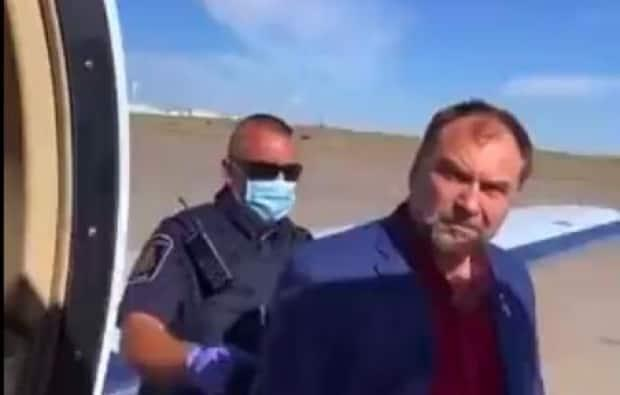 Artur Pawlowski was arrested after returning to Calgary from a U.S. speaking tour during which he met with Donald Trump's son and spread misinformation about vaccines. (@RonFilipkowski/Twitter - image credit)