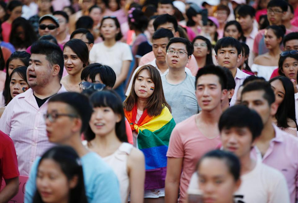 A woman wrapped in the rainbow flag is seen at the Pink Dot rally, Singapore's annual gay pride rally on 1 July, 2017. (Reuters file photo)