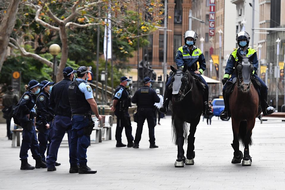 NSW police patrol George St in front of the Sydney Town Hall in anticipation of an anti-lockdown rally in Sydney Sydney, Saturday, July 31, 2021. Source: AAP