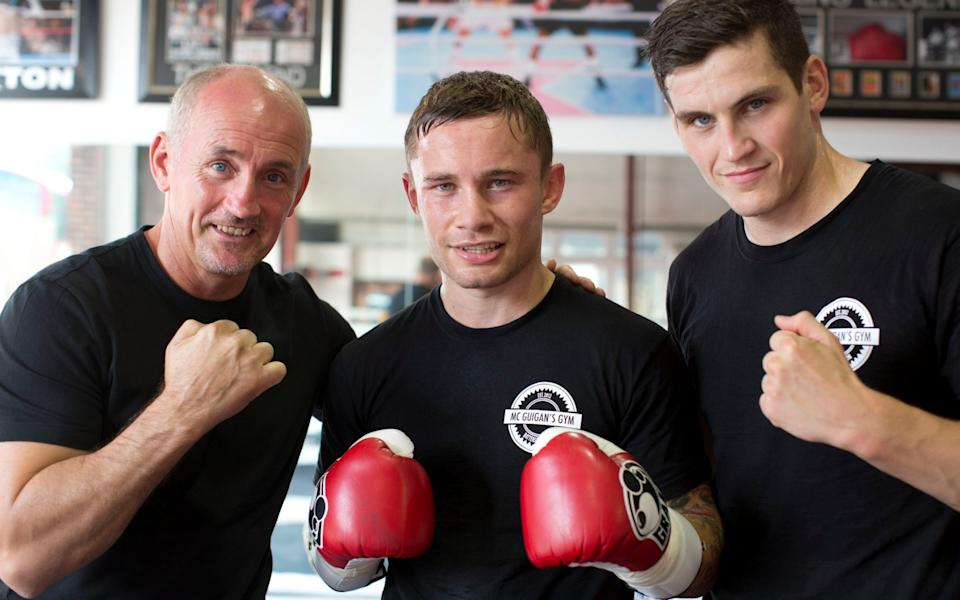 Barry McGuigan pictured in happier times with protege Carl Frampton and his son and trainer Shane McGuigan in 2013 - Heathcliff O'Malley