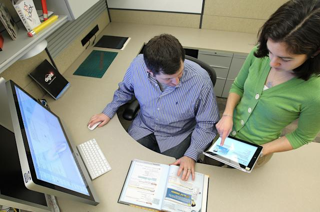 Pearson designers using tools to create digital textbooks. Photo: Pat Greenhouse/The Boston Globe via Getty Images