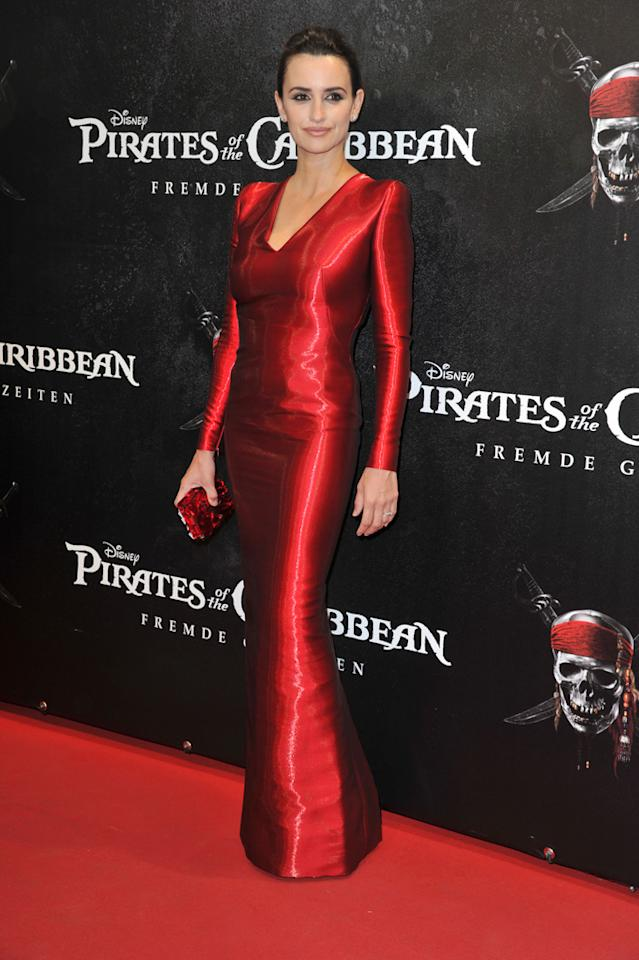 "Penelope Cruz is one red hot mama, with son Leo born in early 2011, in this Armani Prive gown at the Germany premiere of ""Pirates of the Caribbean: On Stranger Tides"" on May 16, 2011."
