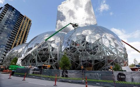 Construction on the Amazon.com campus in downtown Seattle ahead of its opening - Credit: AP