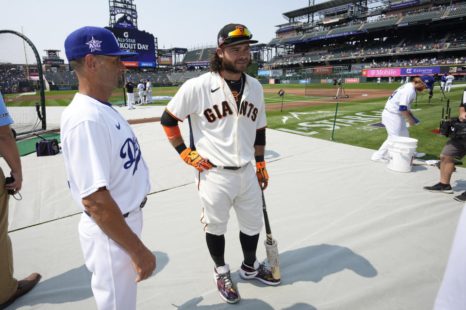National League's Brandon Crawford, of the San Francisco Giants, waits to hit during batting practice for the MLB All-Star baseball game, Monday, July 12, 2021, in Denver. (AP Photo/David Zalubowski)