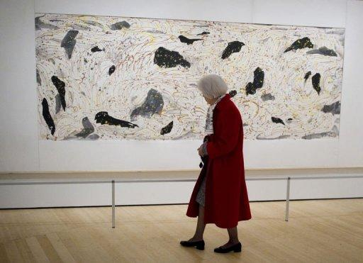 "A woman views a painting titled ""Yellow River"" by Chinese artist Wu Guanzhong at the Asia Society in New York. The first major US retrospective of Chinese artist Wu will fulfill the painter's dying wish to be better known in the West -- and signaling the continued rise of Chinese art on the international stage"