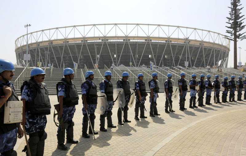 "Rapid Action Force (RAF) personnel stand guard at the Sardar Patel stadium ahead of the visit of U.S. President Donald Trump in Ahmadabad, India, Friday, Feb. 21, 2020. Trump is visiting the city of Ahmedabad in Gujarat during a two-day trip to India to attend an event called ""Namaste Trump,"" which translates to ""Greetings, Trump,"" at a cricket stadium along the lines of a ""Howdy Modi"" rally attended by Indian Prime Minister Narendra Modi in Houston last September. (AP Photo/Ajit Solanki)"