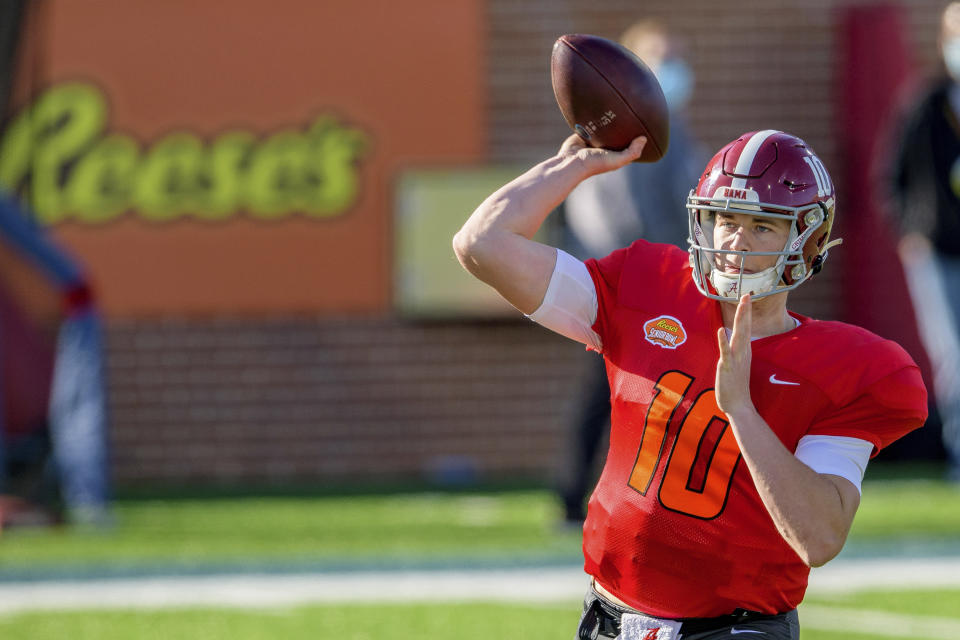 American Team quarterback Mac Jones of Alabama (10) throws during the American Team practice for the NCAA Senior Bowl college football game in Mobile, Ala., Thursday, Jan. 28, 2021. (AP Photo/Matthew Hinton)