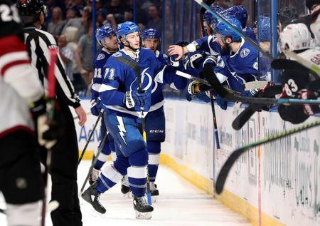 Mar 18, 2019; Tampa, FL, USA; Tampa Bay Lightning center Anthony Cirelli (71) is congratulated after scoring a goal against the Arizona Coyotes during the third period at Amalie Arena. Mandatory Credit: Kim Klement-USA TODAY Sports