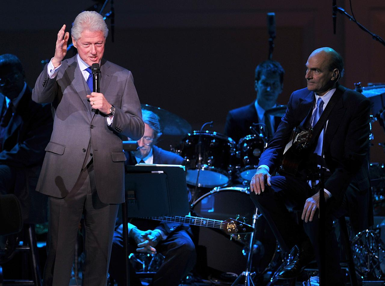 NEW YORK, NY - APRIL 12:  President Bill Clinton speaks with musician James Taylor onstage at the 120th Anniversary of Carnegie Hall on April 12, 2011 in New York City.  (Photo by Stephen Lovekin/Getty Images)