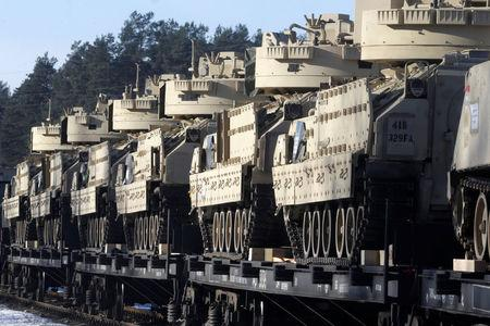 U.S. Bradley fighting vehicles that will be deployed in Latvia for NATO's Operation Atlantic Resolve wait for an unload in Garkalne