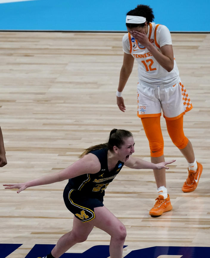 Michigan guard Danielle Rauch celebrates while Tennessee guard Rae Burrell (12) walks off the court after their college basketball game in the second round of the women's NCAA tournament at the Alamodome in San Antonio, Tuesday, March 23, 2021. Michigan won 70-55. (AP Photo/Charlie Riedel)