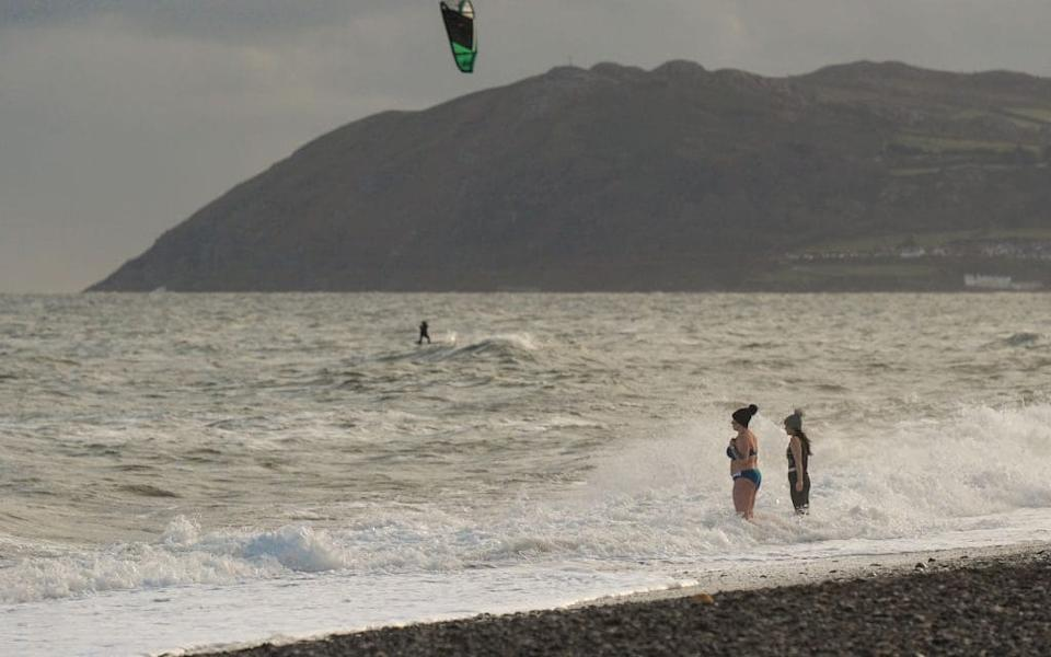 Two Dubliners brave a dip in the sea on Killiney Strand during COVID-19 level 5 lockdown. - GETTY