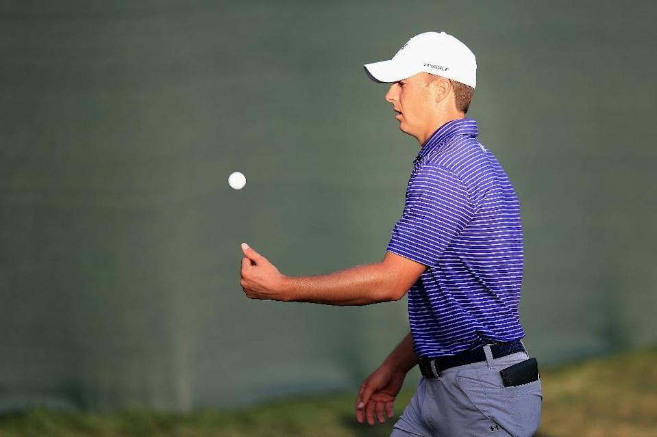 Jordan Spieth tosses a ball at the end of his round on the 18th green during the second round of the Valspar Championship at Innisbrook Resort Copperhead Course on March 11, 2016 in Palm Harbor, Florida (AFP Photo/Sam Greenwood)