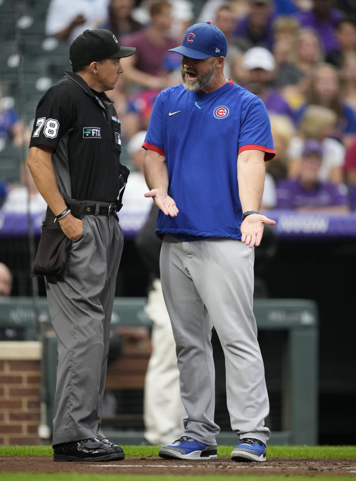 Chicago Cubs manager David Ross, right, argues with home plate umpire Adam Hamari after Hamari ejected him for questioning balls and strikes in the second inning of a baseball game against the Colorado Rockies, Tuesday, Aug. 3, 2021, in Denver. (AP Photo/David Zalubowski)