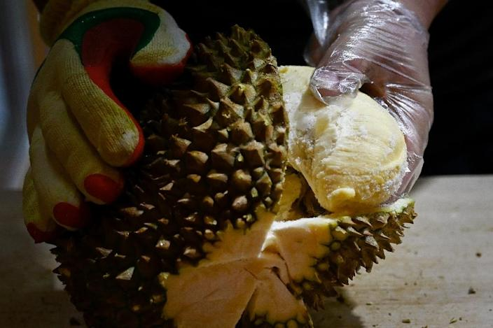 Soaring demand for durians in China is being blamed for a new wave of deforestation in Malaysia with environmentalists warning vast amounts of jungle is being cleared to make way for massive plantations of the spiky, pungent fruit (AFP Photo/WANG ZHAO)