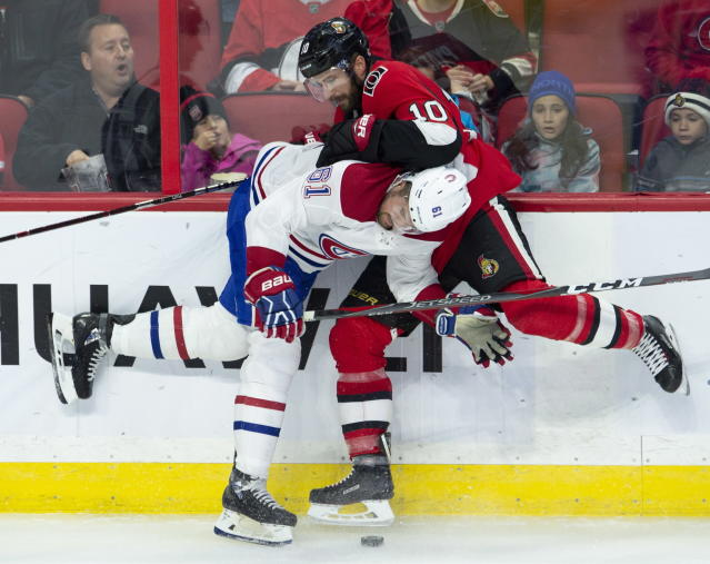 Ottawa Senators left wing Tom Pyatt and Montreal Canadiens defenseman Xavier Ouellet battle for control of the puck along the boards during the first period of an NHL game in Ottawa, Ontario, Saturday, Oct. 20, 2018. (Adrian Wyld/The Canadian Press via AP)