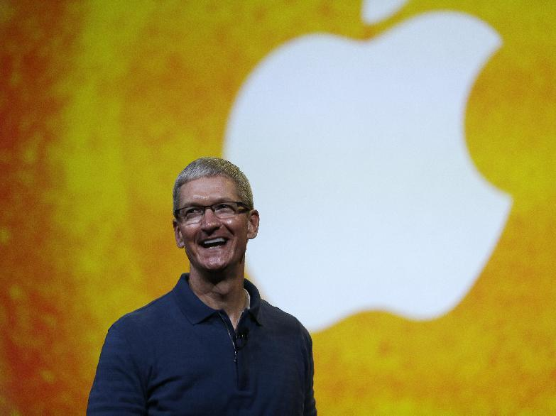"In this Tuesday, Oct.  23, 2012, file photo Apple CEO Tim Cook speaks during an event to announce new products in San Jose, Calif. Apple CEO Tim Cook sought to assure shareholders Wednesday, Feb. 26, 2013, that the company is working on some ""great stuff"" that may help reverse a sharp decline in its stock price.  (AP Photo/Marcio Jose Sanchez, File)"