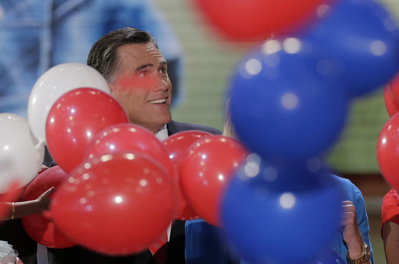 Republican presidential nominee Mitt Romney watches as the balloons fall during the Republican National Convention in Tampa, Fla., on Thursday, Aug. 30, 2012. (AP Photo/J. Scott Applewhite)