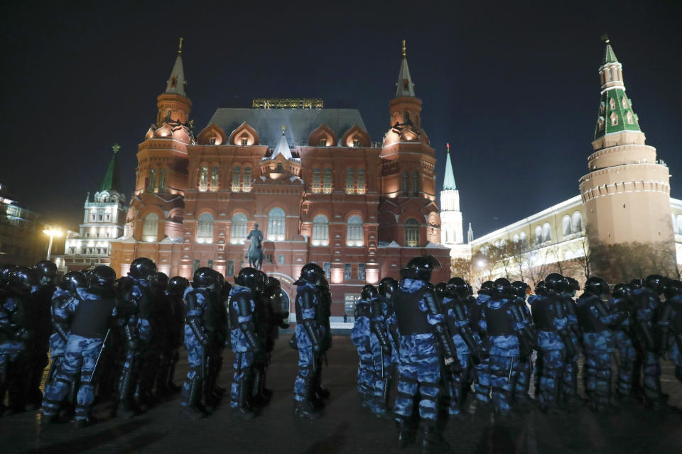 Servicemen of the Russian National Guard (Rosgvardia) gather at the Red Square to prevent a protest rally in Moscow, Russia, Tuesday, Feb. 2, 2021. A Moscow court has ordered Russian opposition leader Alexei Navalny to prison for more than 2 1/2 years on charges that he violated the terms of his probation while he was recuperating in Germany from nerve-agent poisoning. Navalny, who is the most prominent critic of President Vladimir Putin, had earlier denounced the proceedings as a vain attempt by the Kremlin to scare millions of Russians into submission. (AP Photo/Pavel Golovkin)