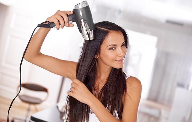 There's actually a way you can half your blow-drying time. Stock image used. Photo: Getty