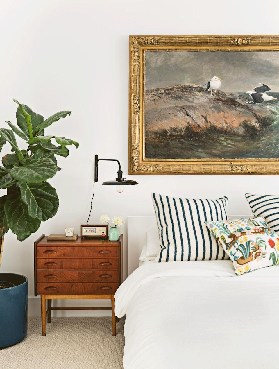 "<p>Highlight your favorite piece with subdued surroundings. Neutral walls, carpeting, and bedding make the perfect backdrop for <a href=""https://www.goodhousekeeping.com/home/decorating-ideas/g1660/stylish-family-friendly-home/"" rel=""nofollow noopener"" target=""_blank"" data-ylk=""slk:a master bedroom"" class=""link rapid-noclick-resp"">a master bedroom</a>'s focal point: a big, bold seascape.</p>"