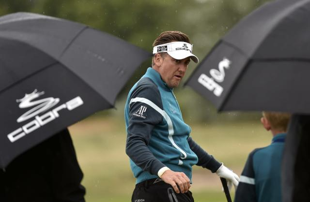 Ian Poulter of England practices on the driving range ahead of the British Open Championship at the Royal Liverpool Golf Club in Hoylake, northern England July 16, 2014. REUTERS/Toby Melville (BRITAIN - Tags: SPORT GOLF)