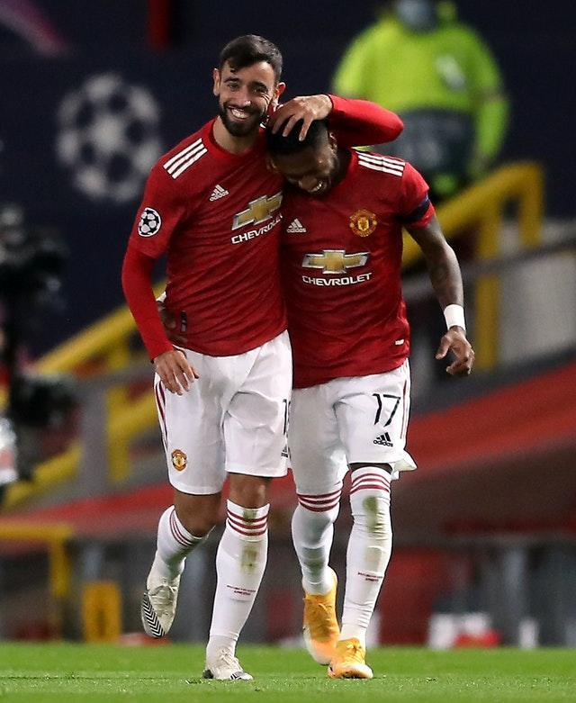 Manchester United's Bruno Fernandes (left) celebrates scoring his side's first goal of the game with team-mate Fred