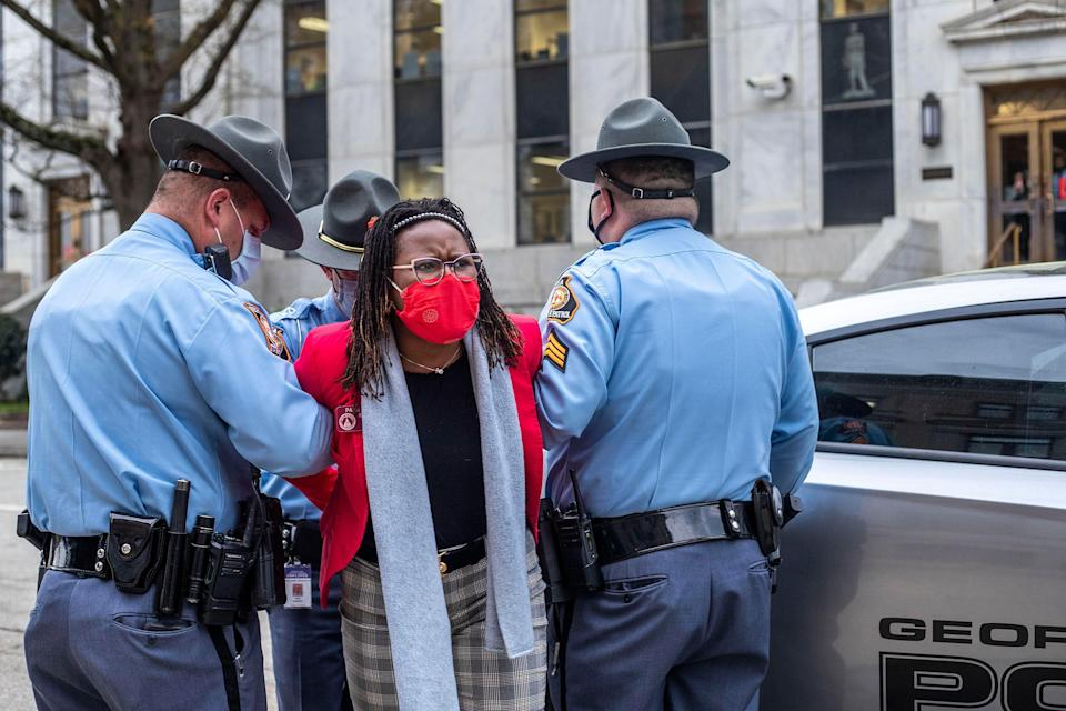 State Rep. Park Cannon (D) is placed into the back of a Georgia State Capitol patrol car after being arrested by Georgia state troopers. (Photo: Alyssa Pointer/Atlanta Journal-Constitution via Associated Press)