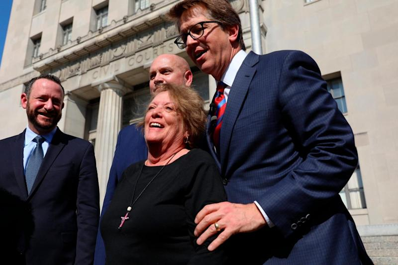 Plaintiff Gail Ingham, foreground, of O'Fallon, Mo., stands outside the civil courthouse with attorneys Lee Cirsch, from left, Eric Holland and Mark Lanier following a verdict against health care giant Johnson & Johnson (AP)