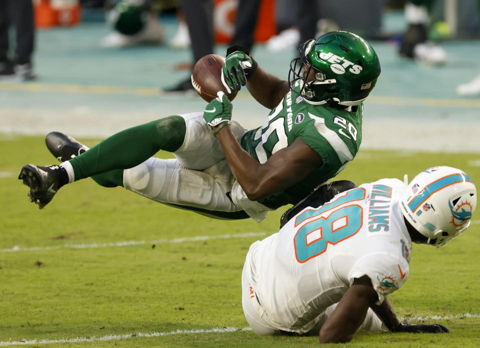 Marcus Maye grabs for the ball while falling to the ground.