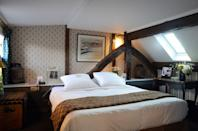 """A 10-minute drive from the <a href=""""https://www.cntraveler.com/activities/eiffel-tower?mbid=synd_yahoo_rss"""" rel=""""nofollow noopener"""" target=""""_blank"""" data-ylk=""""slk:Eiffel Tower"""" class=""""link rapid-noclick-resp"""">Eiffel Tower</a>, this is peak <a href=""""https://www.cntraveler.com/destinations/paris?mbid=synd_yahoo_rss"""" rel=""""nofollow noopener"""" target=""""_blank"""" data-ylk=""""slk:Paris"""" class=""""link rapid-noclick-resp"""">Paris</a> in one of the world's most romantic cities. Ideally located for exploring the Left Bank, this boutique four-star owned by celebrity chef Yves Camdeborde—whose much-lauded <a href=""""https://www.cntraveler.com/restaurants/paris/le-comptoir?mbid=synd_yahoo_rss"""" rel=""""nofollow noopener"""" target=""""_blank"""" data-ylk=""""slk:Le Comptoir"""" class=""""link rapid-noclick-resp"""">Le Comptoir</a> sits on the ground floor, and where guests are able to skip perennial lines—has earned loyalists with its warm service, quirky charm, and high-quality in-house eats. Camdeborde serves gourmet bistro menus crafted with fresh local products, paired with vintages from his friends' wineries. A few doors down, the chef also oversees the Avant Comptoirs (de la Terre, de la Mer, and du Marché, respectively), separate spaces for casual pre-dinner or late-night drinks, charcuterie boards, and other shared bites. Actual rooms are spread throughout the 17th-century building, each inspired by a writer with ties to Paris, from Balzac and Dumas to Marguerite de Navarre, but the homages are subtle—a portrait or vintage typewriter here, a bicycle in another. The decor varies between spaces, but all have wood-beamed ceilings, boldly-patterned wallpaper or curtains, tea-making facilities, and views of the Carrefour de l'Odéon."""