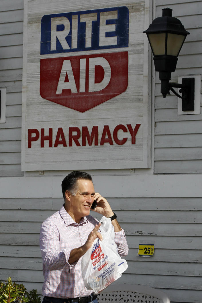 Republican presidential candidate, former Massachusetts Gov. Mitt Romney walks out of Rite Aid Pharmacy in Wolfeboro, N.H., Monday, Aug. 6, 2012. (AP Photo/Charles Dharapak)