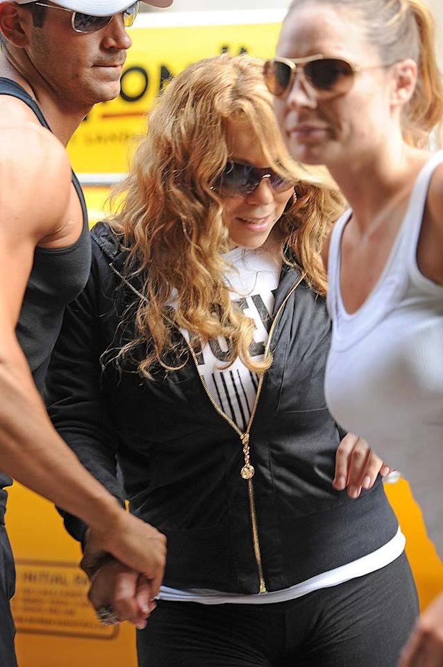 """The <i>Daily Mail</i> reports that Mariah Carey recently """"ordered a $1,600 bottle of Angel champagne – and had it delivered to the ladies' toilet"""" at Juliet Supperclub in New York. The paper says the new mom was also """"fanned by a male assistant"""" throughout the entire evening. For the inside scoop on Carey's bathroom champagne party, and more dish on her shocking """"diva behavior,"""" click over to <a href=""""http://www.gossipcop.com/mariah-carey-toilet-bathroom-champagne-juliet-supperclub/"""" target=""""new"""">Gossip Cop</a>. JosiahW/<a href=""""http://www.splashnewsonline.com"""" target=""""new"""">Splash News</a> - June 7, 2011"""